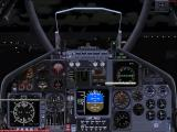 On board the USS George Washington, inside a Tomcat at night.