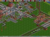 Transport Tycoon Deluxe Windows Temperate scenery with factory and steam train in 1956