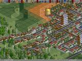 Transport Tycoon Deluxe Windows Small rich town on a desert/tropical map.