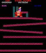 Donkey Kong Arcade He climbs up the scaffolding, then jumps on it so that it collapses