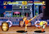 Fatal Fury Special Arcade Joe Higashi hits with a high kick. As the rounds change, so do the backgrounds, signaling the passing of time.