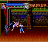 Super Double Dragon SNES Billy facing off against an enemy and the suit-using boss with a Boomerang.