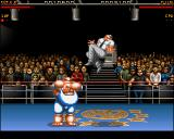 Body Blows Amiga Dug fights with Mike on the Wrestling Arena (AGA version).