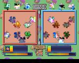 Jigsaw Madness PlayStation A two player battle in progress. In each picture the darker pieces represent pieces placed by the opponent.