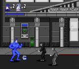 The Tick Genesis Fighting gangsters outside of a bank. Note the power-up on the ground
