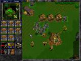 Warcraft II: Battle.net Edition Windows Knights attack an Orcish Base