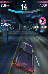 Asphalt: Overdrive Android Performing a stunt in a tunnel with a fast Ferrari.
