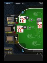 Big Fish Casino iPad Playing a hand of Blackjack (names and pictures blurred for privacy)