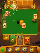 Pyramid Solitaire Saga iPad I released a scarab. Now I need to tap it to collect points.