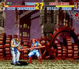 Fatal Fury Special Sharp X68000 Billy Kane using his staff against Kim Kaphwan