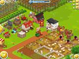 Hay Day iPad Main view of the game. Some buildings produce goods, others for storage, and plots for farming and farm animals.