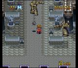 Terranigma SNES Angry-looking metallic guardians hit me with their S&M accessories in a castle dungeon