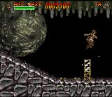 Indiana Jones' Greatest Adventures SNES Indy chased by a giant rock