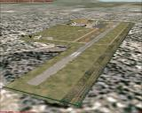 Scenery Spain: Balearic Islands Windows Mallorca - Son Bonet airfield. The first airport on Mallorca, now a private airfield. Terminal in left corner, hangars at the far end. (FS2000)