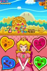 Super Princess Peach Nintendo DS Attacking some goombas with a koopa shell.