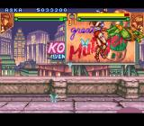 "Teenage Mutant Ninja Turtles: Tournament Fighters SNES Aska performing a ""Dragon Punch"""