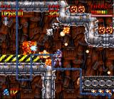 Super Turrican SNES Conveyor belts, flamethrowers, falling rockets and small pesky enemies will keep you busy in this stage