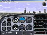 Microsoft Flight Simulator 98 Windows Flying through Chicago, with the Sears Tower in the distance.