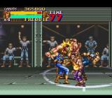 Final Fight 2 SNES Carlos taking a beating