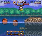 The Magical Quest Starring Mickey Mouse SNES Jumping over slippery tree trunks.