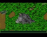 Jungle Strike Amiga Level 8 - A tomahawk missile hidden in a mountain and a tank.