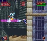 Super Turrican 2 SNES Climbing a wall while fighting off enemies