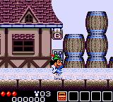 Legend of Illusion starring Mickey Mouse Game Gear Picking up a stone and carrying it