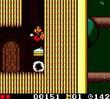 Land of Illusion starring Mickey Mouse Game Gear Jumping on a treasure chest to get cake