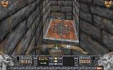 Heretic: Shadow of the Serpent Riders DOS A downward view of a teleporter