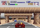 OutRun Genesis Driving under some stone structures