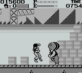 Kung' Fu Master Game Boy The second boss is throwing barrels at you. Just go to the left side of the screen where he can't reach them.